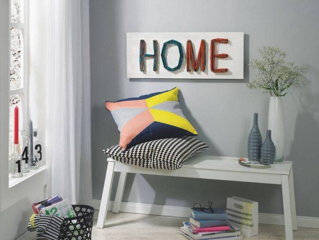 Ein Präsent mit persönlicher Note: Das selbstgebastelte Wandbild aus einer Holzplatte und vielen bunten Fäden lässt sich ganz nach Wunsch gestalten.
