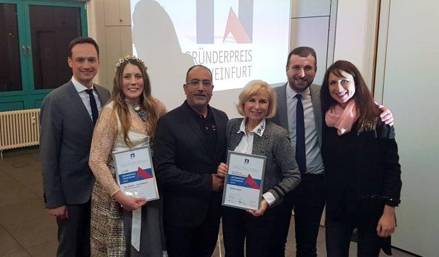 Das Foto zeigt die Riege der Schonunger Gewinner mit Landrat Florian Töpper, Eva Glöckner (MainDirndl), Susanne und Felix Puello (PEXCO), Bürgermeister Stefan Rottmann und Christina Diem-Puello (PEXCO).